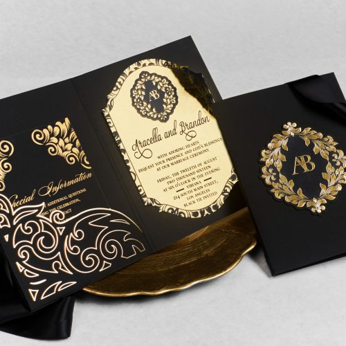 A bold bifold invitation with luxurious acrylic and a custom foil stamped pocket.